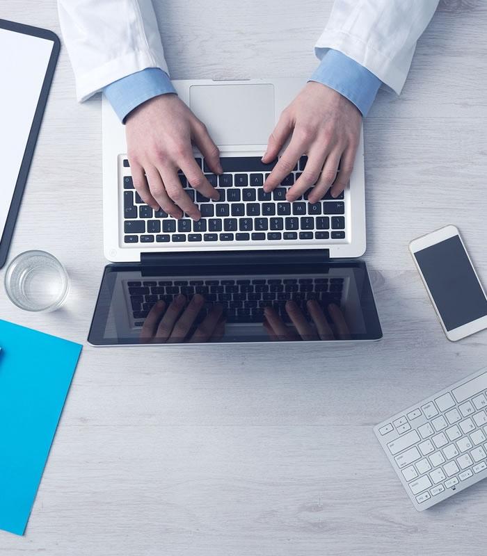 medics hands on laptop